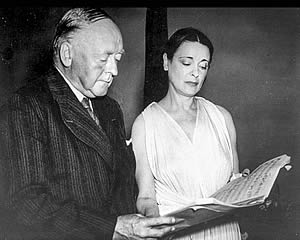 Arnold Bax and Harriet Cohen with the score of the left hand Concertante, Royal Albert Hall 25th July 1950